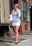 Leggy Blake Lively shows legs and cleavage (with downblouse canddis) getting out of taxi in NYC